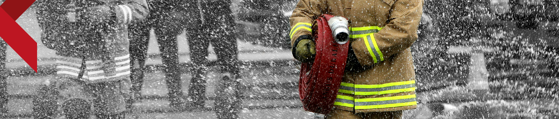 Firefighter carrying a hose