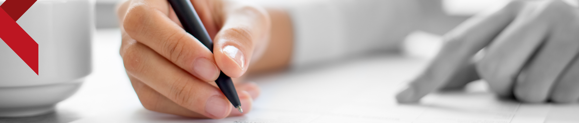 Close up of someone signing a form