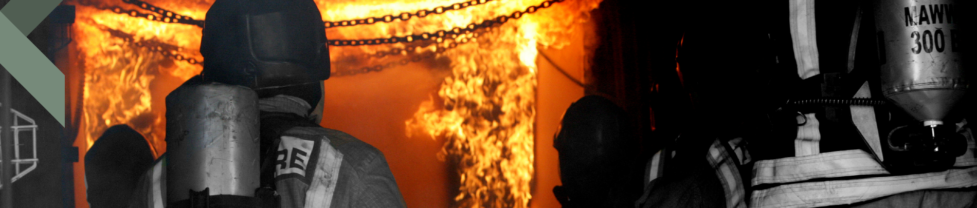 Firefighter battling flames during an excercise