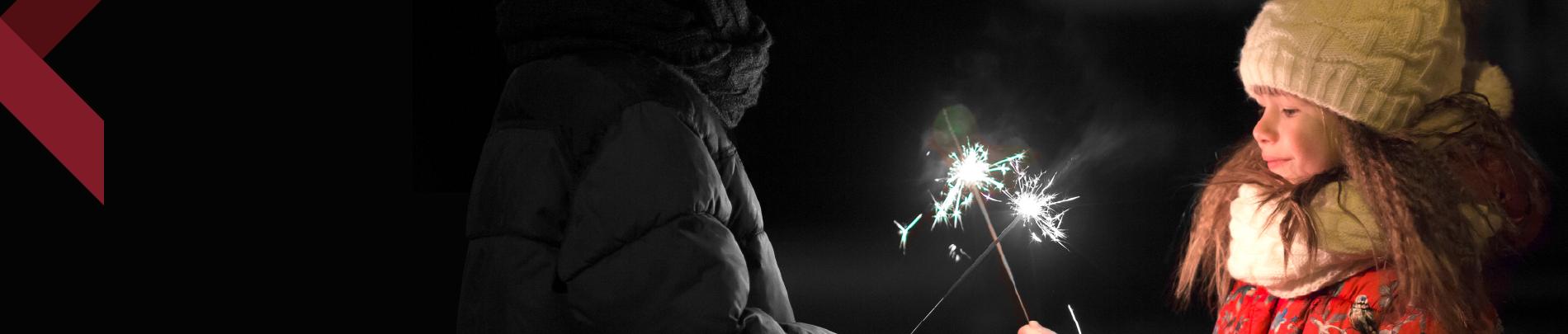 Child holding sparkler