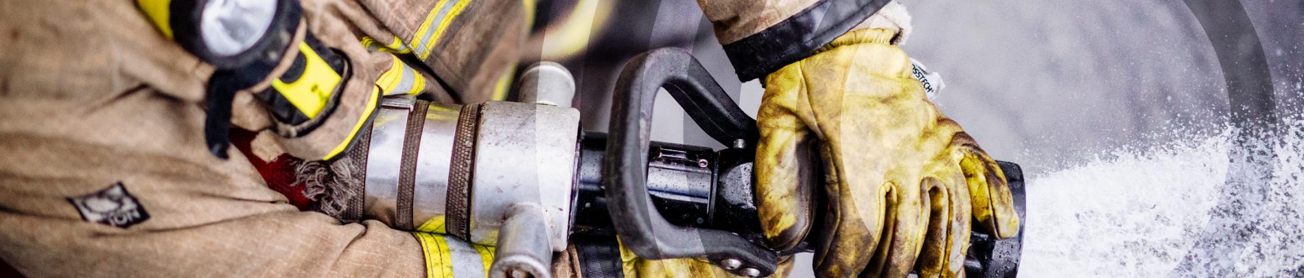 Firefighter using a hose